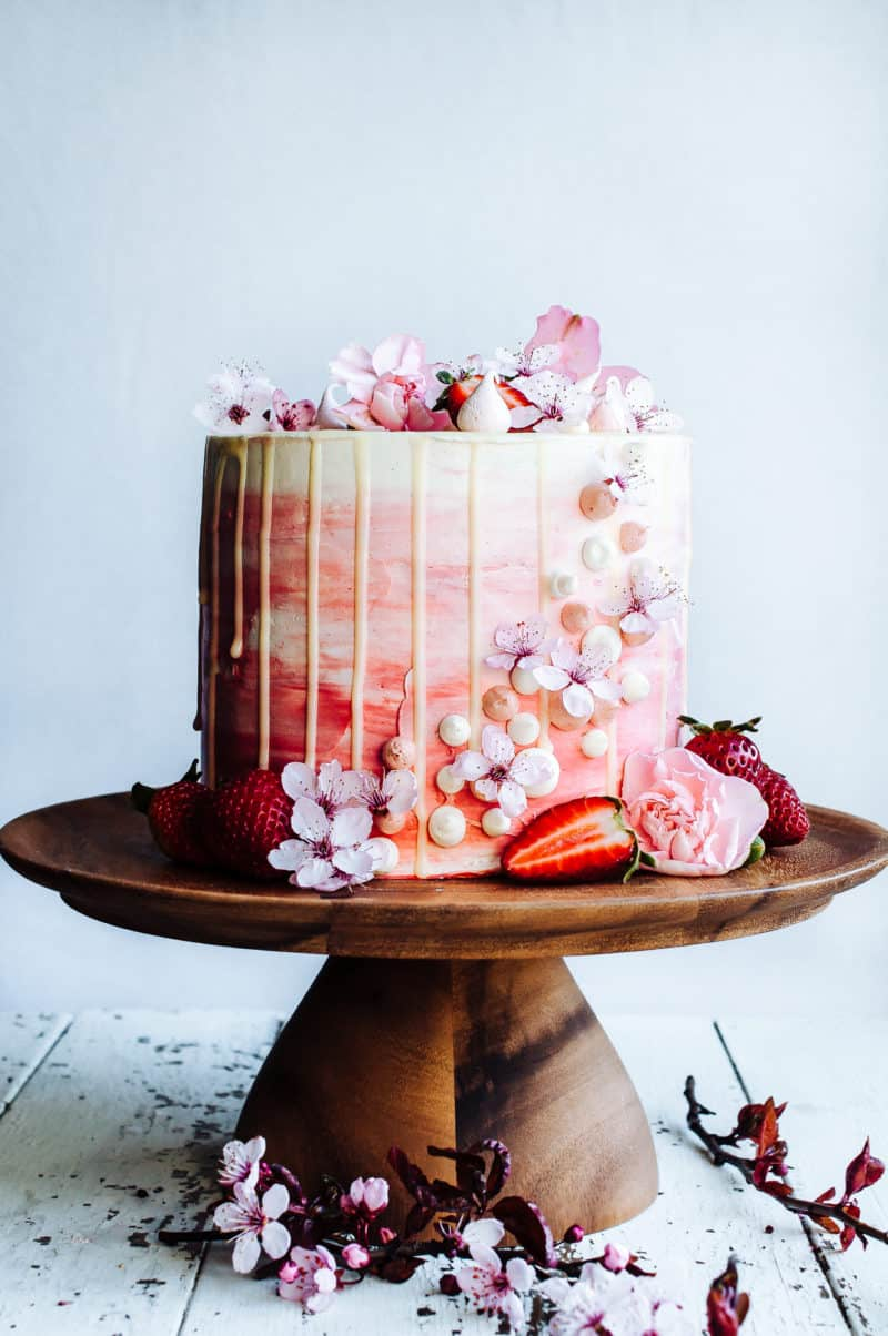 strawberry cake on wooden cake stand