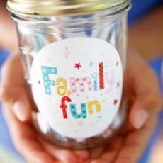 hands holding family fun activity jar