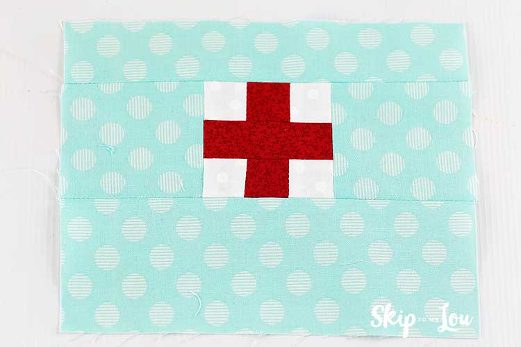 sew top and bottom of red cross