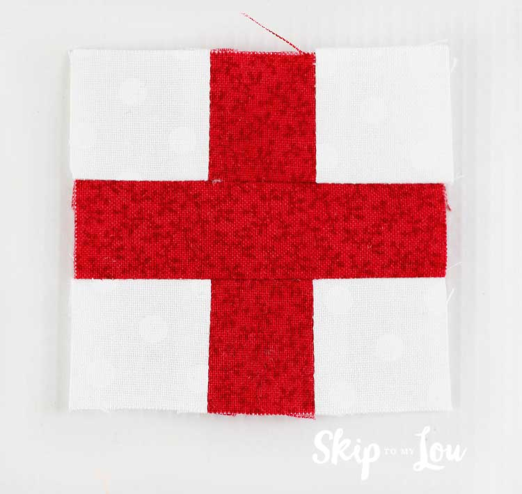sew middle of first aid cross