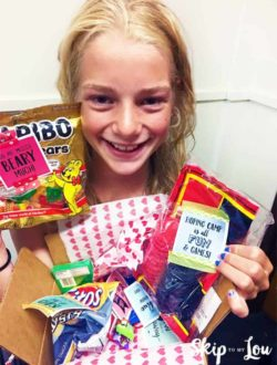 kid holding camp care package