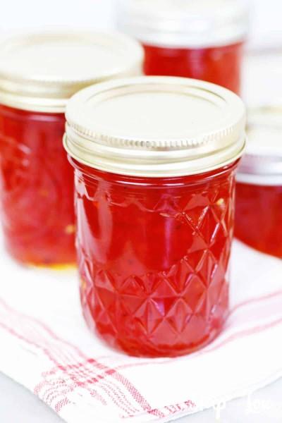 hot pepper jelly in jars lids fingertip tight
