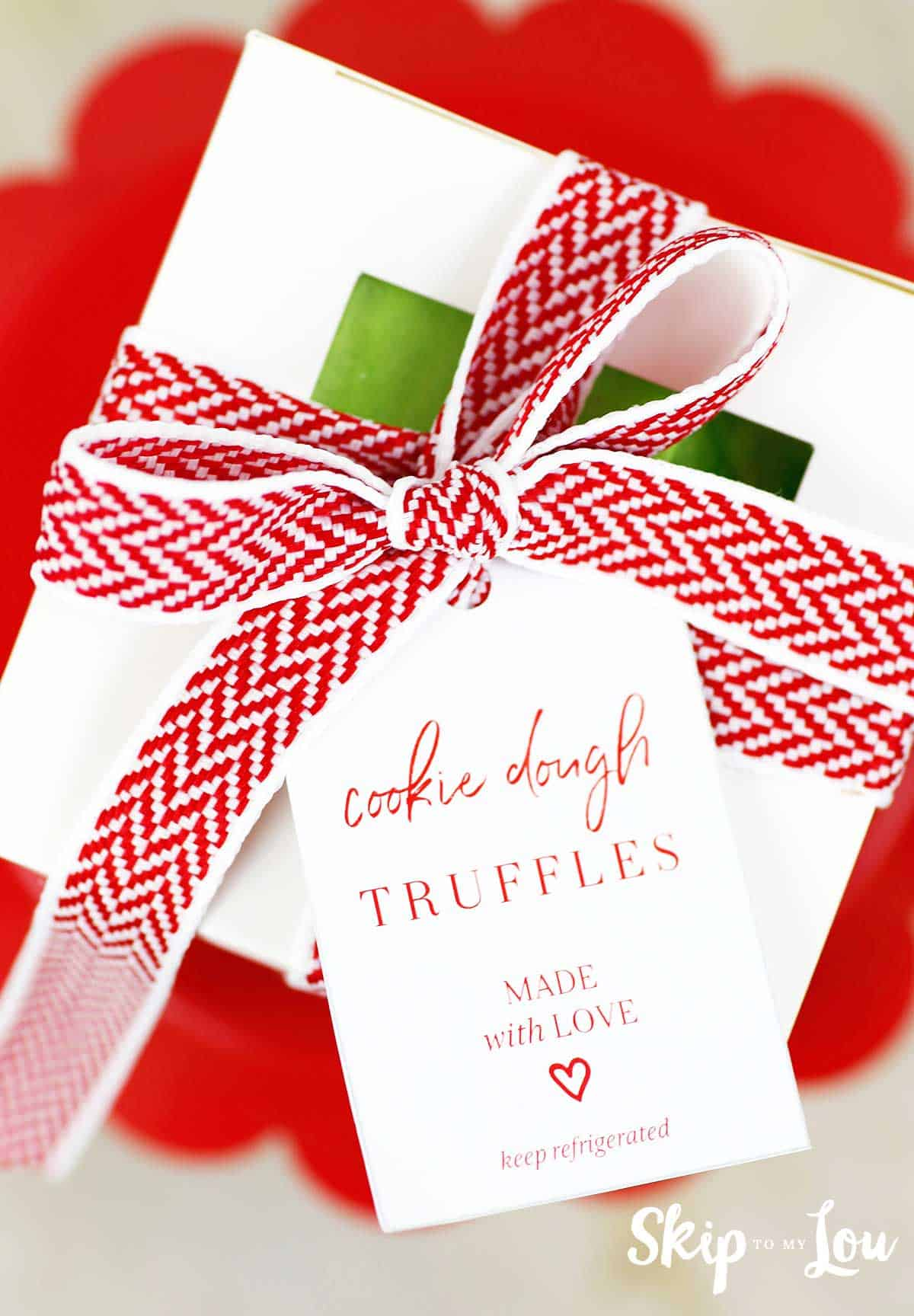 cookie dough truffles edible gift with read and white ribbon bow and cookie dough truffles made with love gift tag