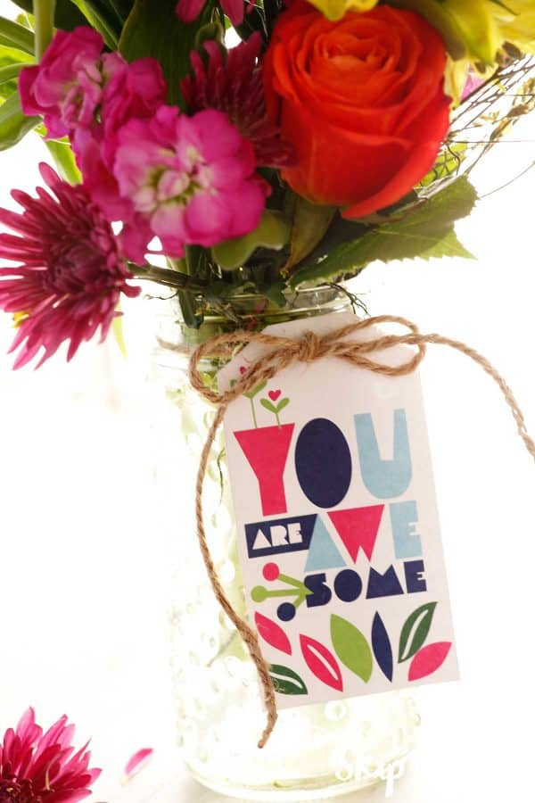 flowers in glass jar with you are awesome tag