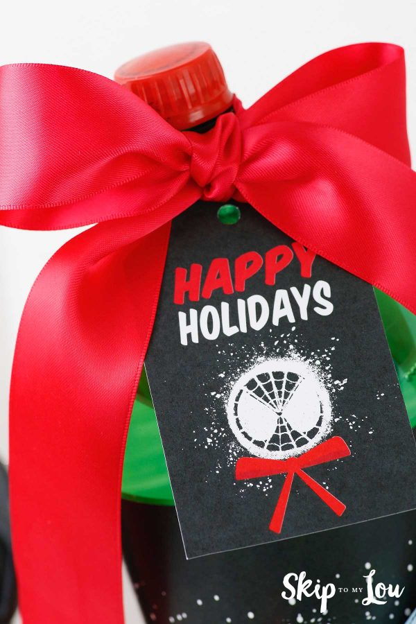 Happy Holidays gift tag on soda bottle