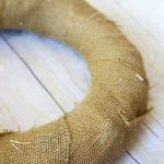 wrap straw wreath form with strip of burlap