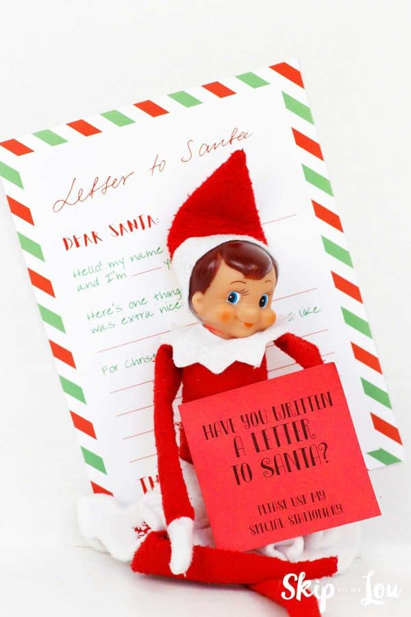 elf with letter to santa and post it note asking if you have written your letter