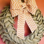 burlap wreath with orange chevron bow on orange door