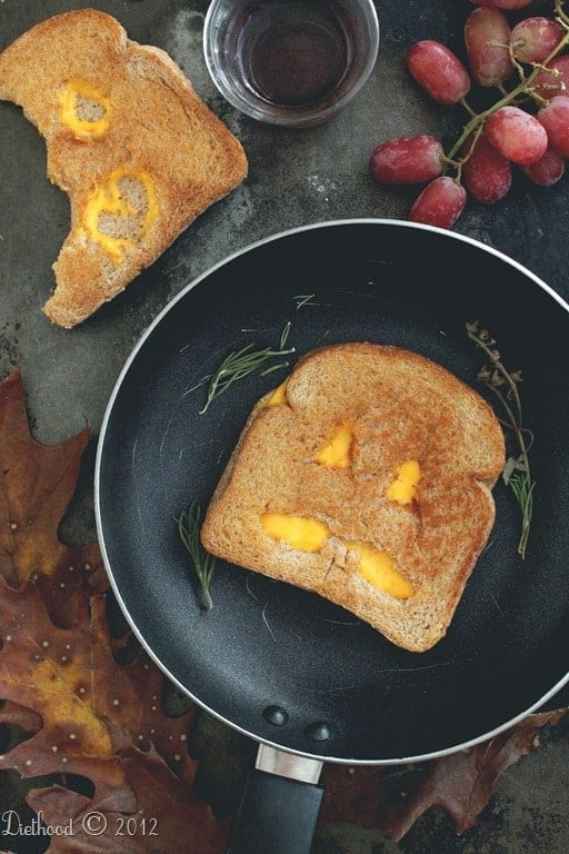 grilled cheese jack o lantern in pan