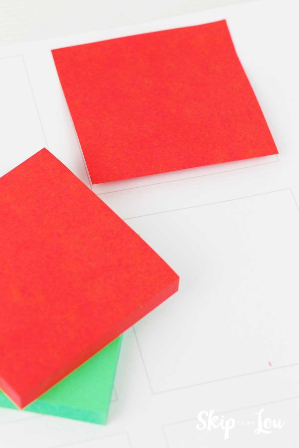 red and green post it notes on template