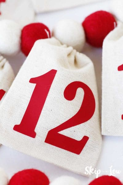 red number 12 on white muslin bag