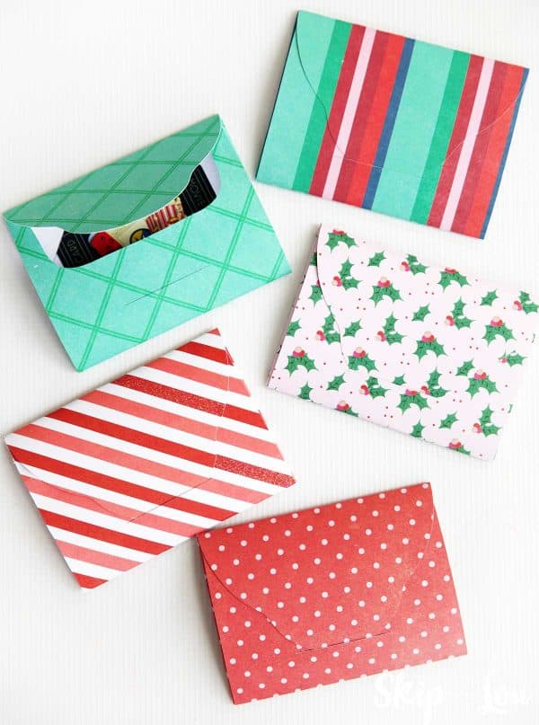 colorful paper gift card holders on white background