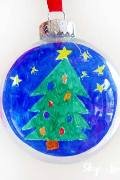 round glass ornament with childs artwork of christmas tree