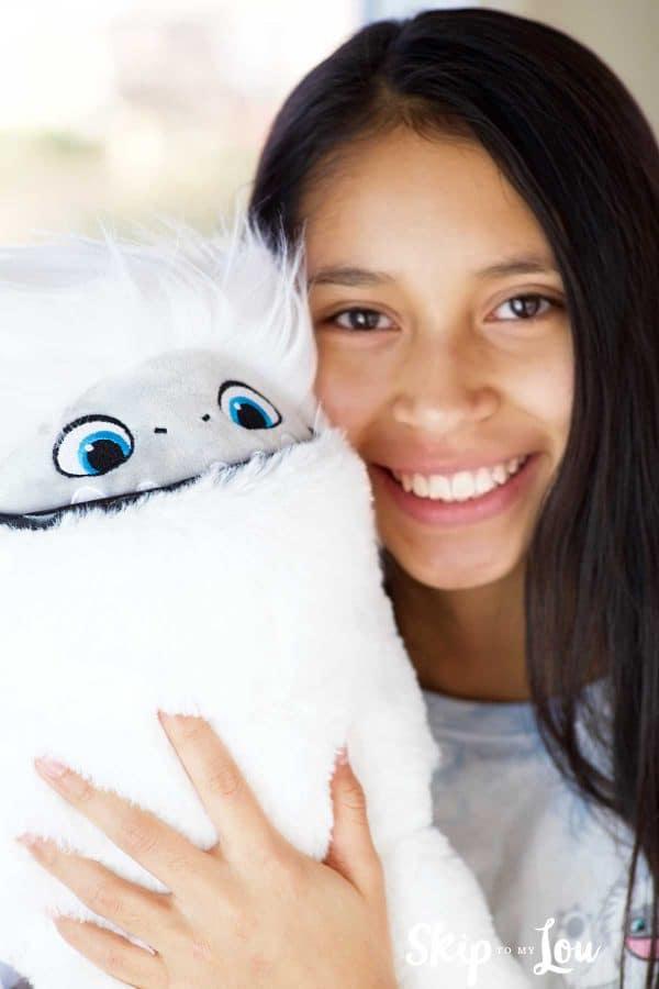 child holding Abominable yeti stuffed animal