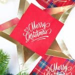 red personalized merry christmas napkin on gold star plate plaid custom Christmas napkins on side