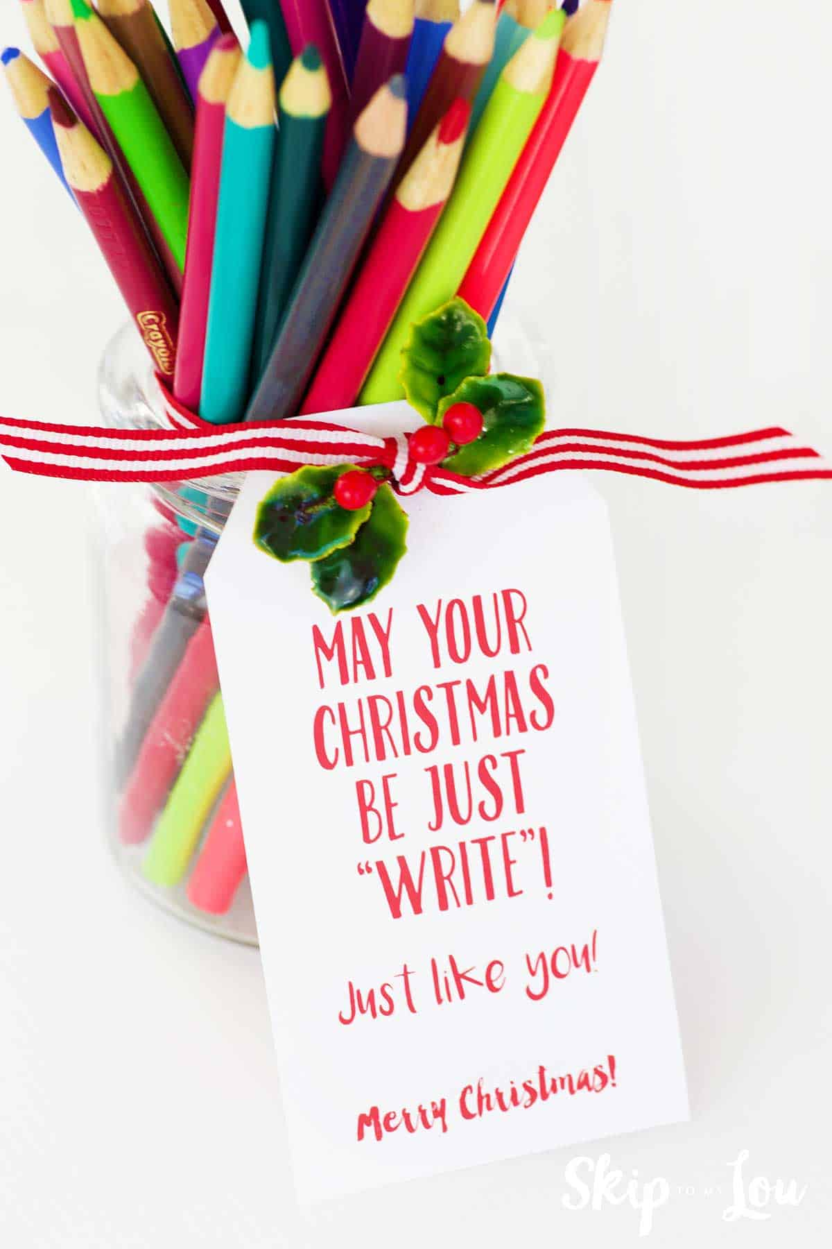 glass jar filled with colored pencils with you are just write gift tag