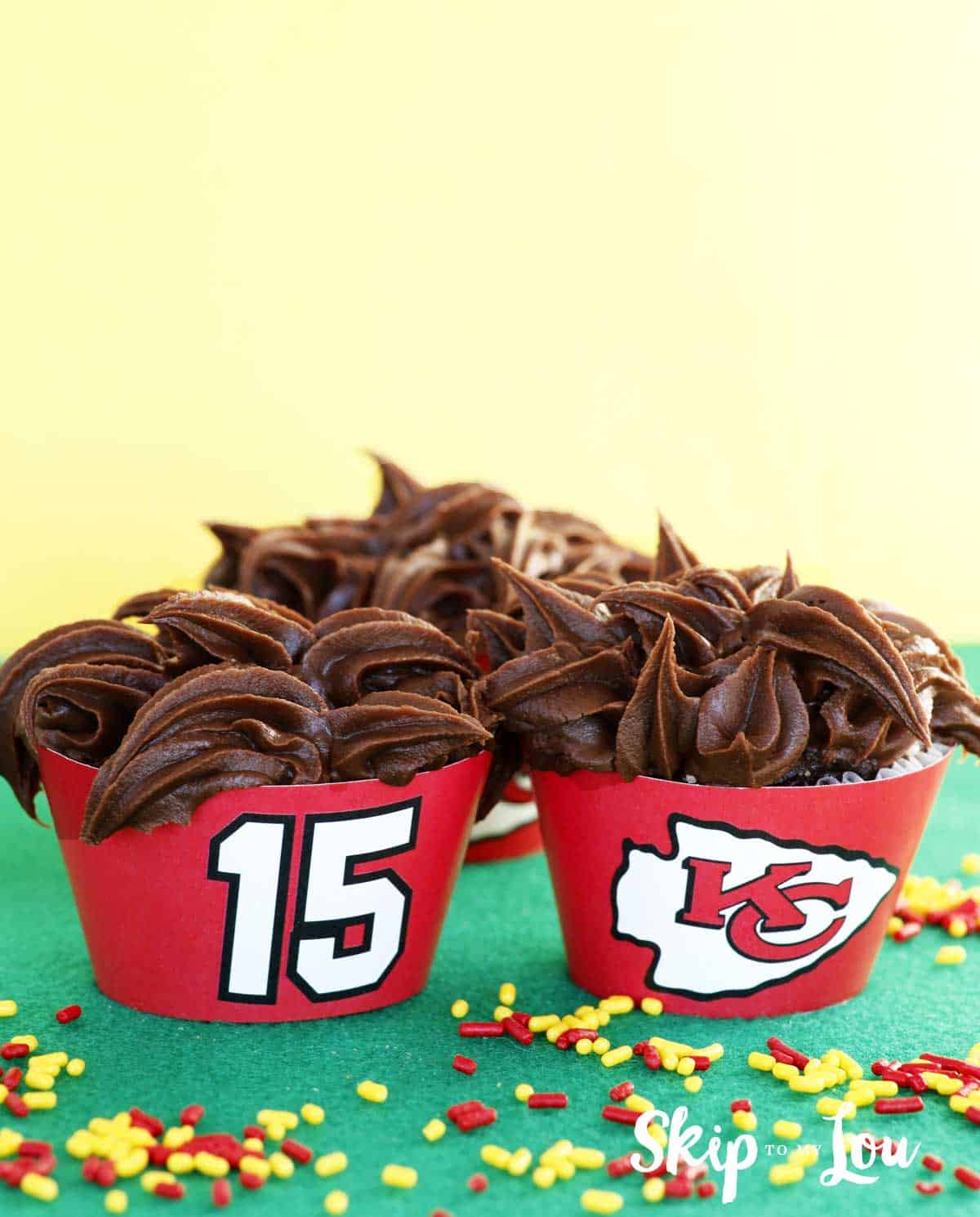two cupcakes with kansas city chiefs logo and #15 free printable wrappers