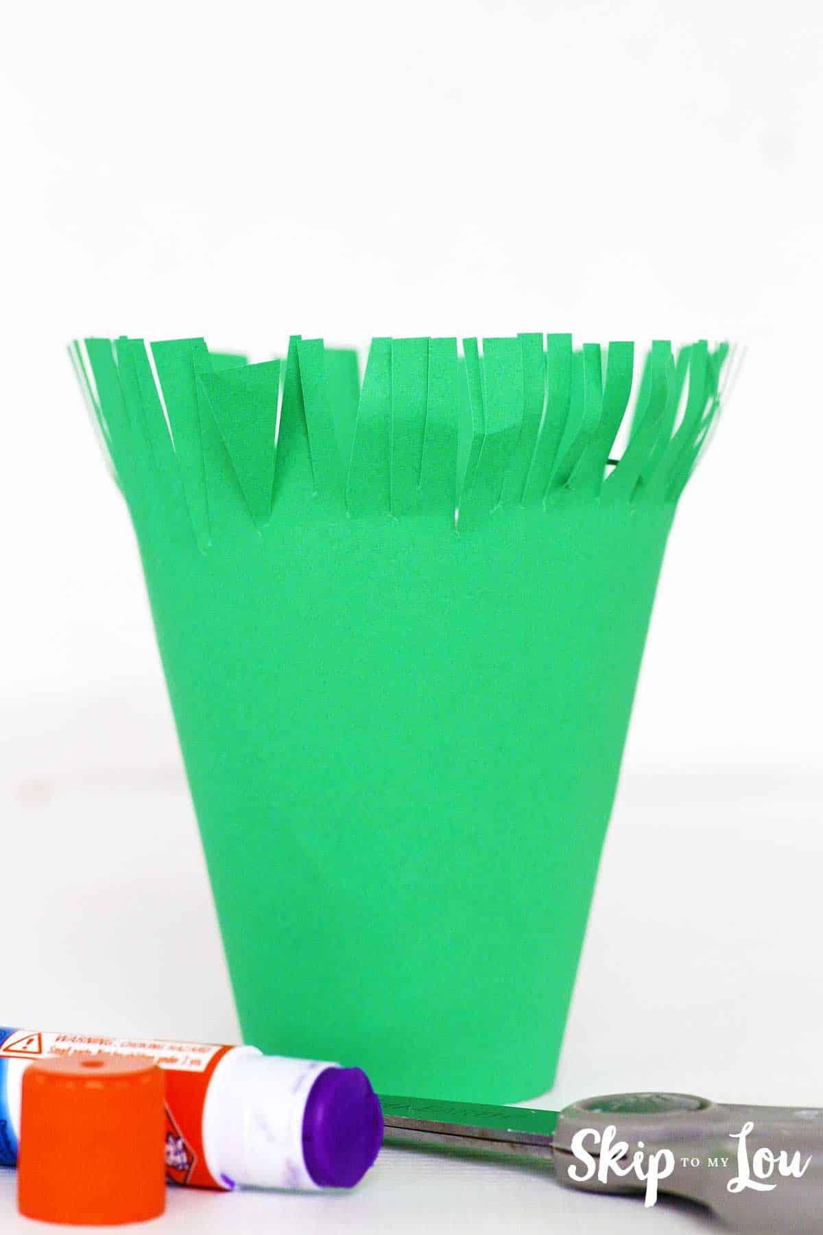 foam cup covered in green paper