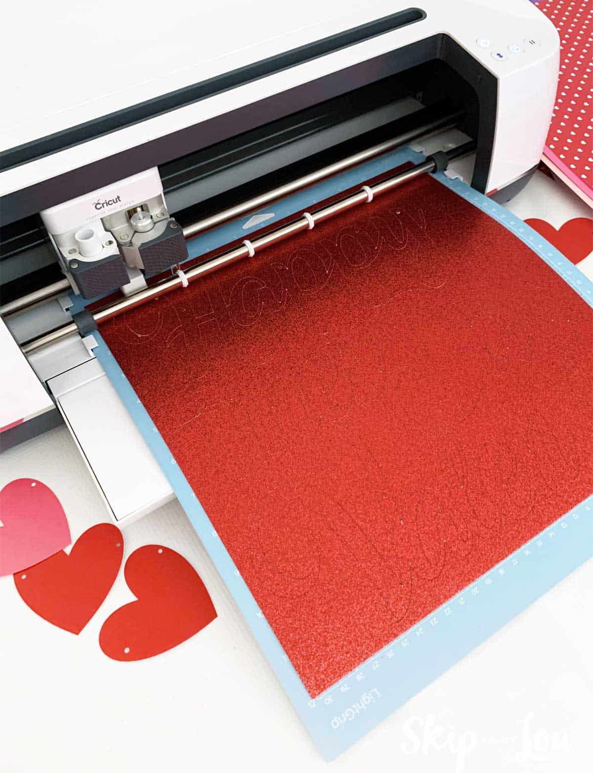 red glitter cardstock loaded in Cricut Maker