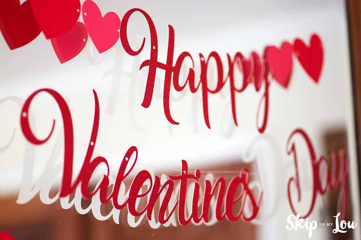 Red Glitter Valentine Banner hanging on mirror