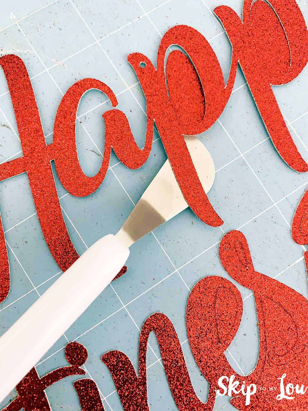 Removing letter from mat with cricut spatula