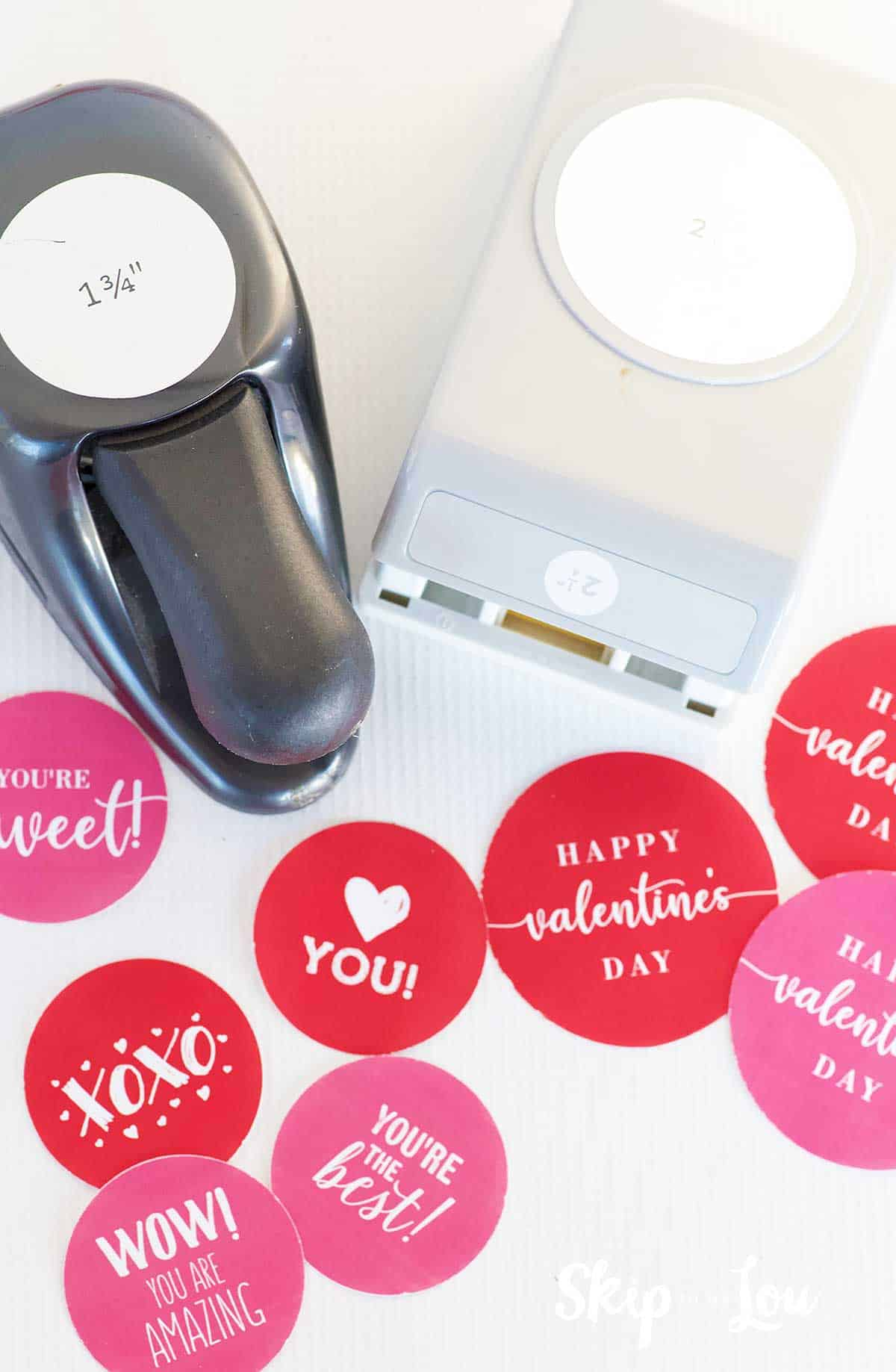 two circle punches with punched out Valentine stickers