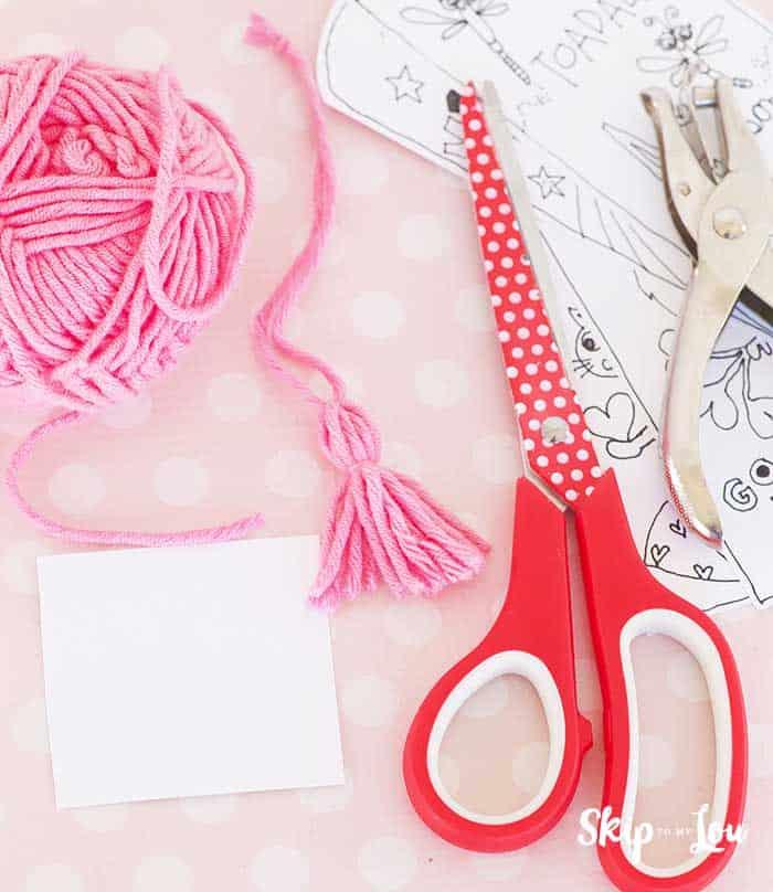 scissors hole punch yarn to make tassel for book mark