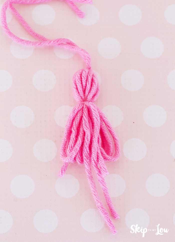 tie knot around tassel