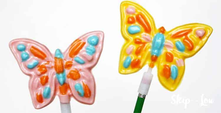 two colorful butterfly suckers make from candy melts