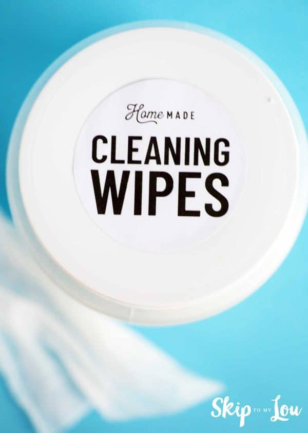 DIY cleaning wipe labels on plastic container blue background