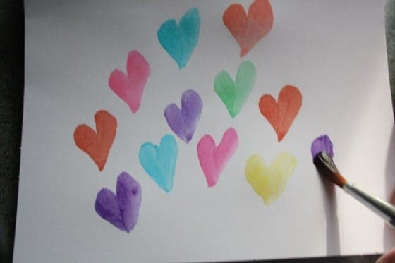 watercolor hearts painted on white paper