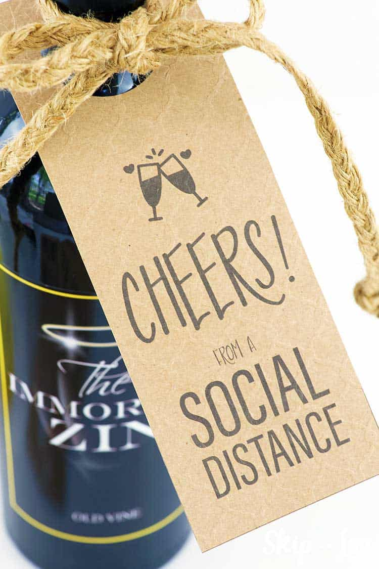 Cheers from a social distance wine tag on wine bottle with twine bow