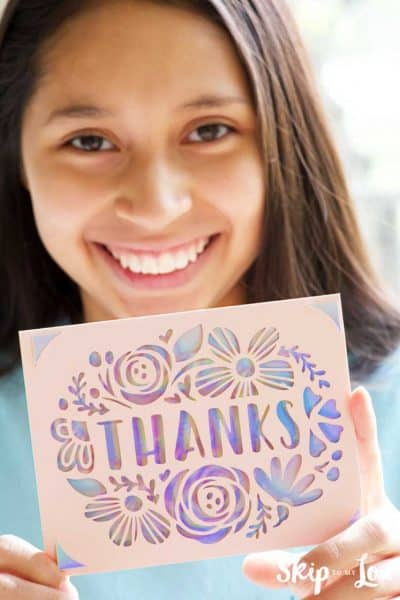 child with thanks card made with cricut joy