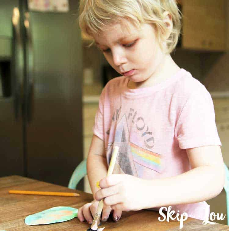 child painting paper egg shape
