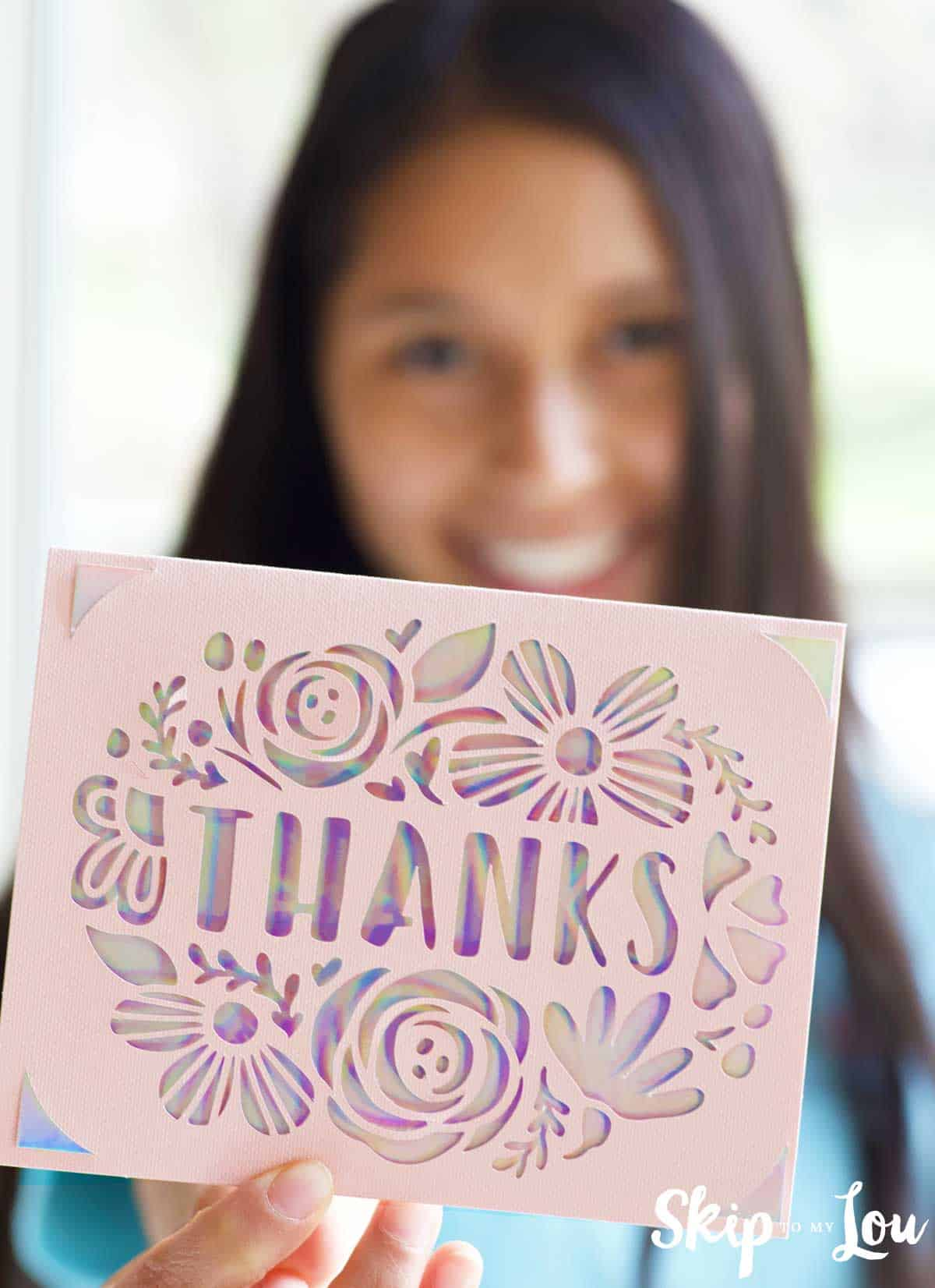 girl holding cricut joy cut thanks card