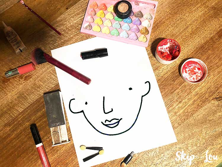 free printable make up face with make up around edge sitting on table