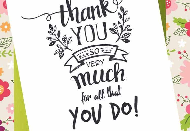 printable thank you card laying on green envelope