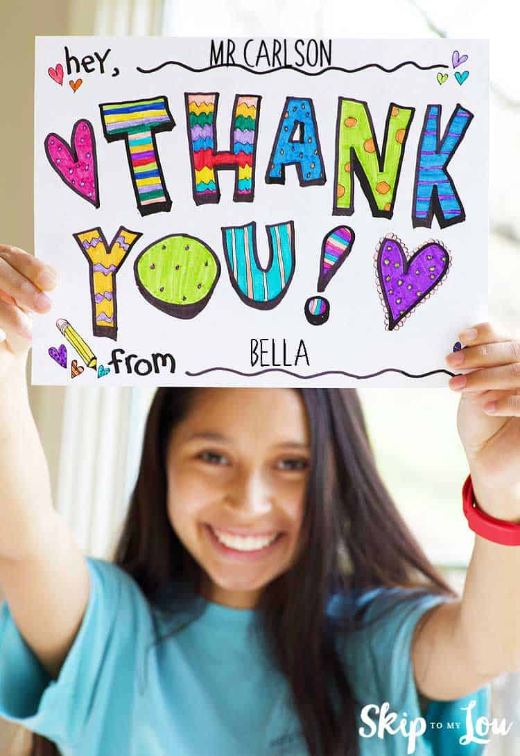 child holding printable thank you sign hand colored