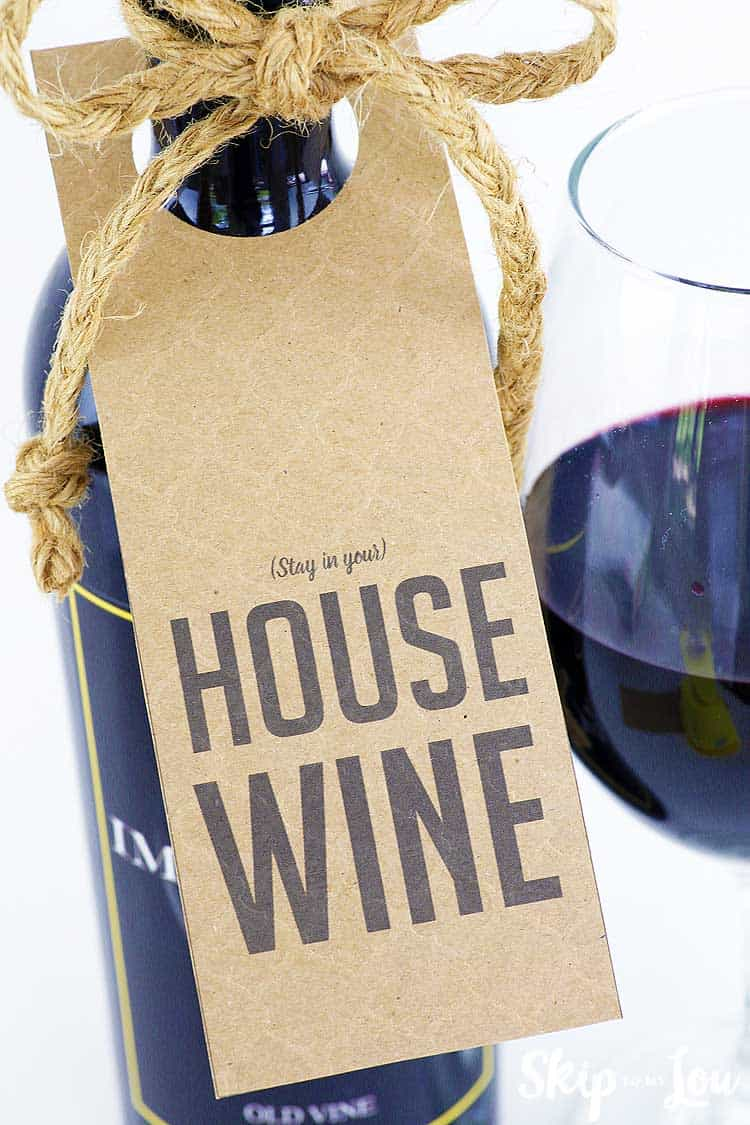 stay in your house wine tag on wine bottle with glass of wine to side