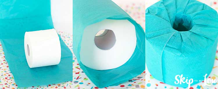 wrapping toilet paper roll in colored tissue paper