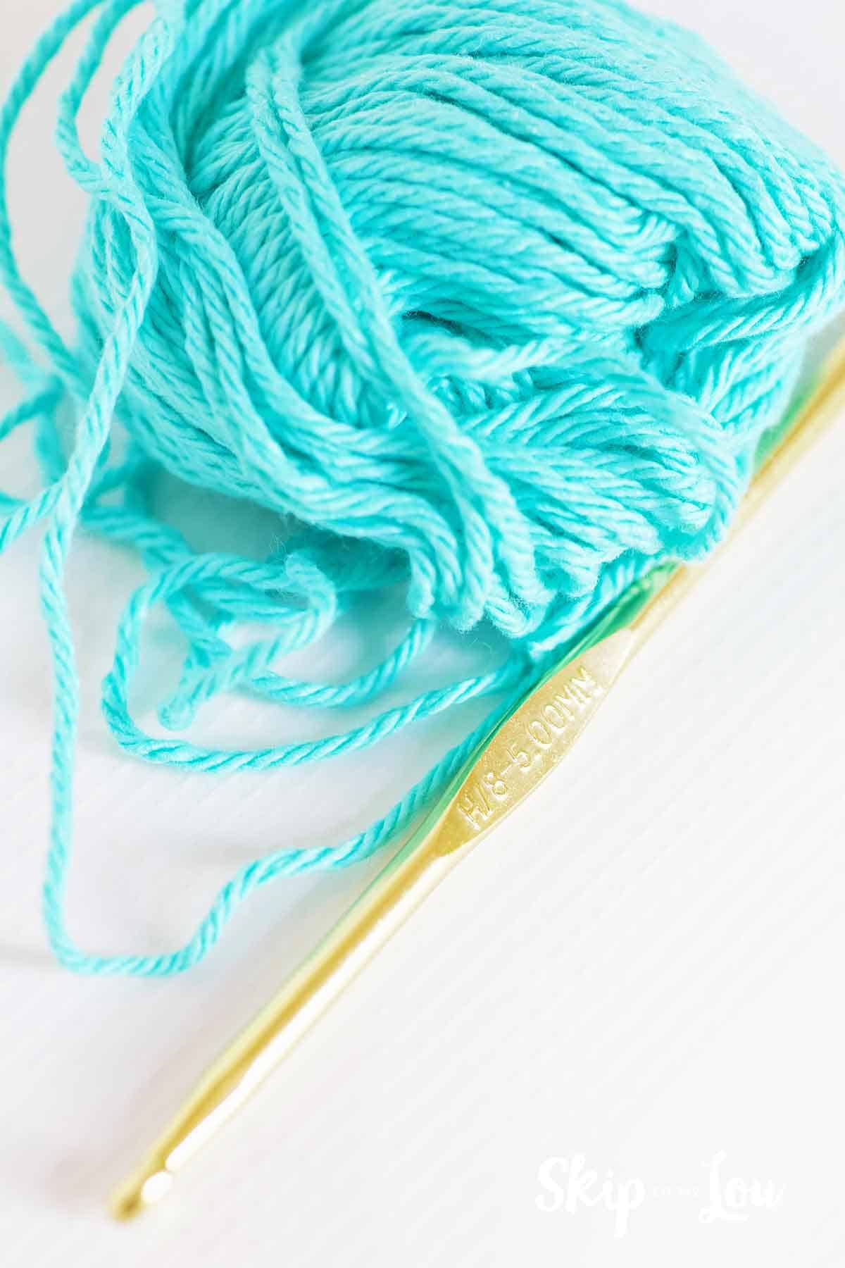 cotton yarn next to H crochet hook