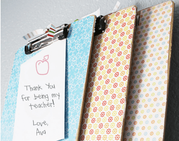 three decorated clipboard one with a thank you note to teacher clipped to the front
