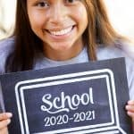 virtual learning back to school sign girl holding