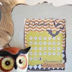 countdown calendar in white frame ceramic owl sitting next to it
