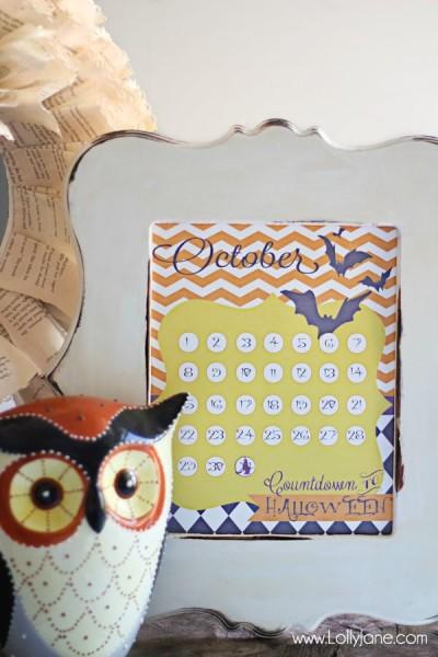 countdown calendar in white frame ceramic owl sitting next to it