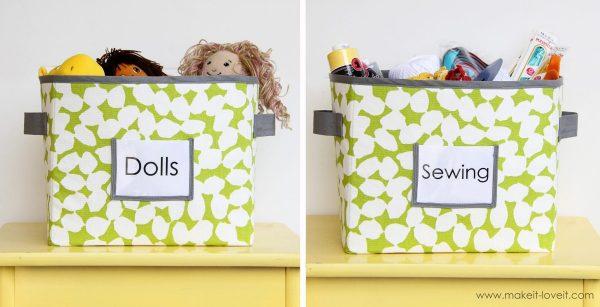 Two fabric bins with lime green and white fabric, with gray lining, trim and handles; each bin is labeled identifying what is in them, the first is labeled Dolls and the second is labeled sewing