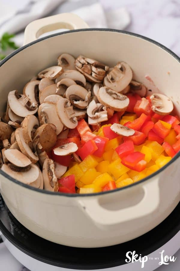 chopped red and yellow bell pepper and sliced mushrooms add to the browned chicken for the weight loss soup