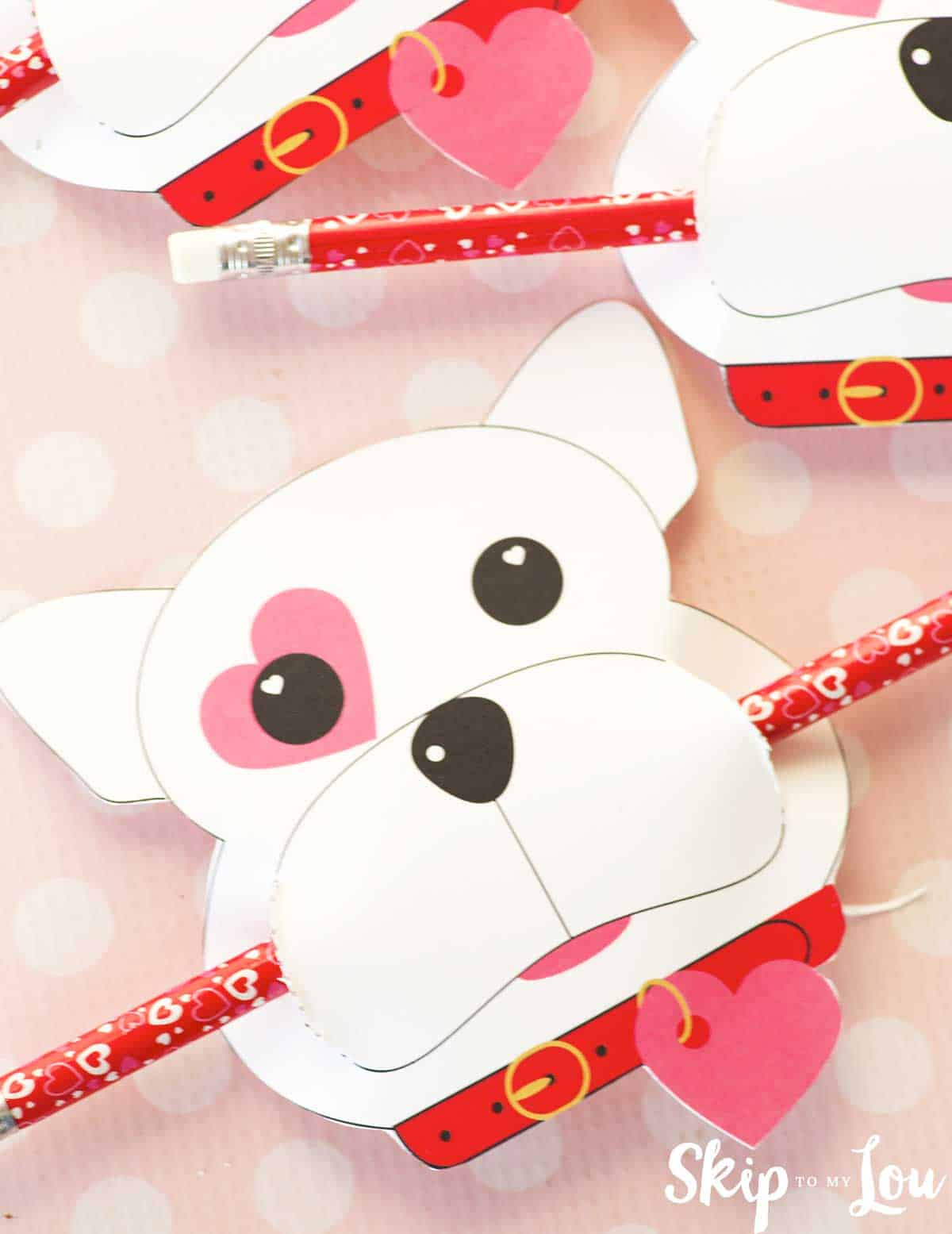 puppy dog valentine with a pencil in mouth