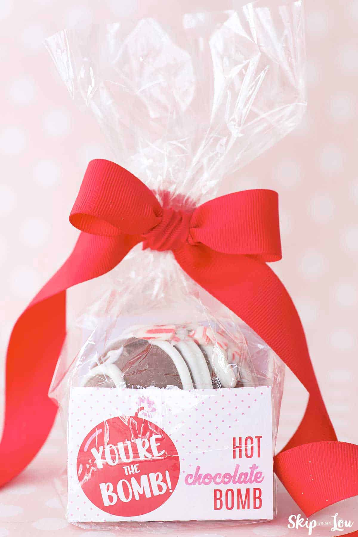 cocoa bomb in red and white Valentine's Day Packaging