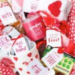 box filled with small red and white gifts box of love care package